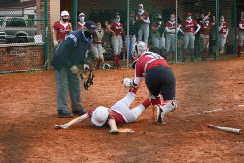 Centerfielder Kaitlyn Flowers slides into home plate on a Macie Zink squeeze bunt, narrowly avoiding the tag to give the Grenadiers a 1-0 victory over IU South Bend in Game 1 of a doubleheader on Feb. 27.