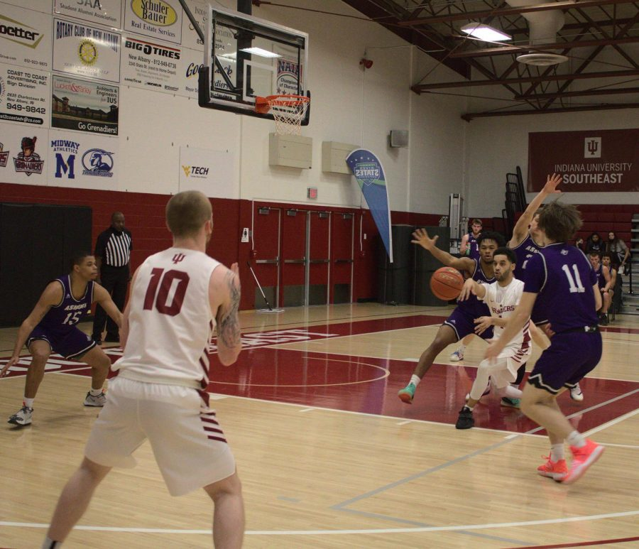 John Kinnaird Jr. draws three Asbury defenders before passing to Jared Osborne (#10) for a wide-open three-point attempt during in the first half against the Eagles on Feb. 6.