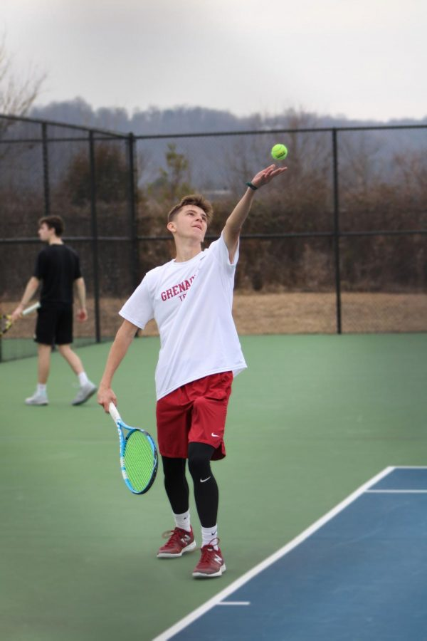 Sophomore Jerid Inman prepares to serve to Georgetown's Hunter Nosek during the Grenadiers' home match against the Tigers on Feb. 27. Inman defeated Nosek at #3 Singles 6-0, 6-3