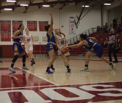 Junior Lauren Lambdin attempts to maneuver around Brescia