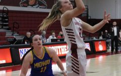 Guard Lauren Lambdin puts up a floater after getting around Midway's Kindall Talley on Feb. 20.