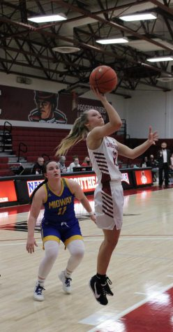 Guard Lauren Lambdin puts up a floater after getting around Midway