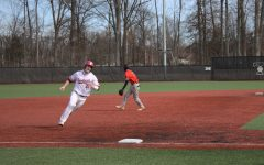 Senior Matt Monahan rounds third base before scoring as a result of Jake Scott's two-run single in the first game of a doubleheader against Pikeville on Feb. 6.