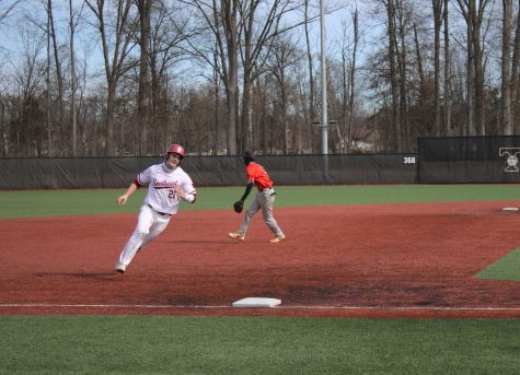 Senior Matt Monahan rounds third base before scoring as a result of Jake Scott