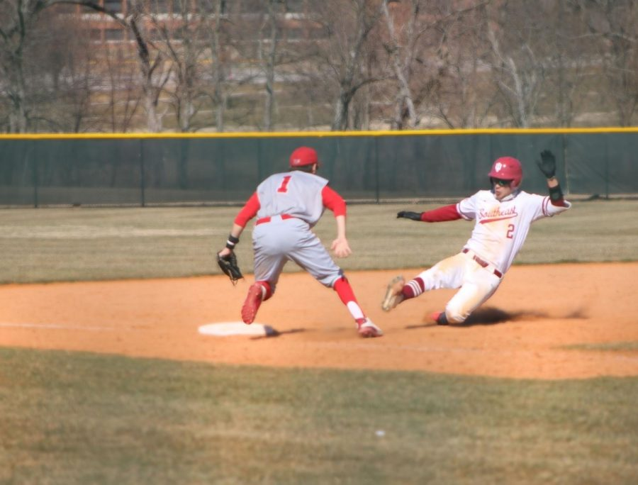 Clay Woeste slides into third base after hitting a triple to centerfield during game one of a doubleheader against Rio Grande on March 6.
