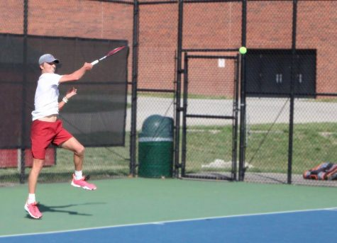 Freshman Connor Mason returns a volley against Asbury