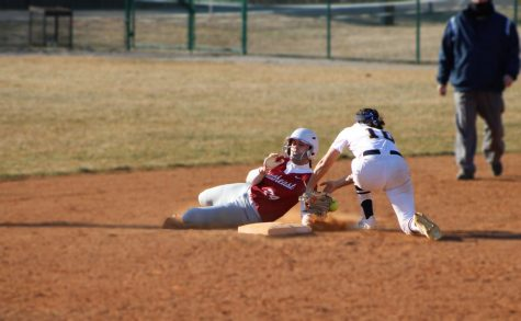 Ellie Jackman barely beats the tag of Siena Heights