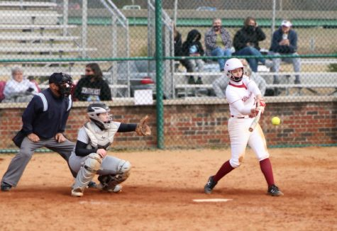 Ellie Jackman rips an RBI single to centerfield, driving in Ysa Fox. The hit completed a late Grenadier rally to take game two of a doubleheader against Huntington University on March 13.
