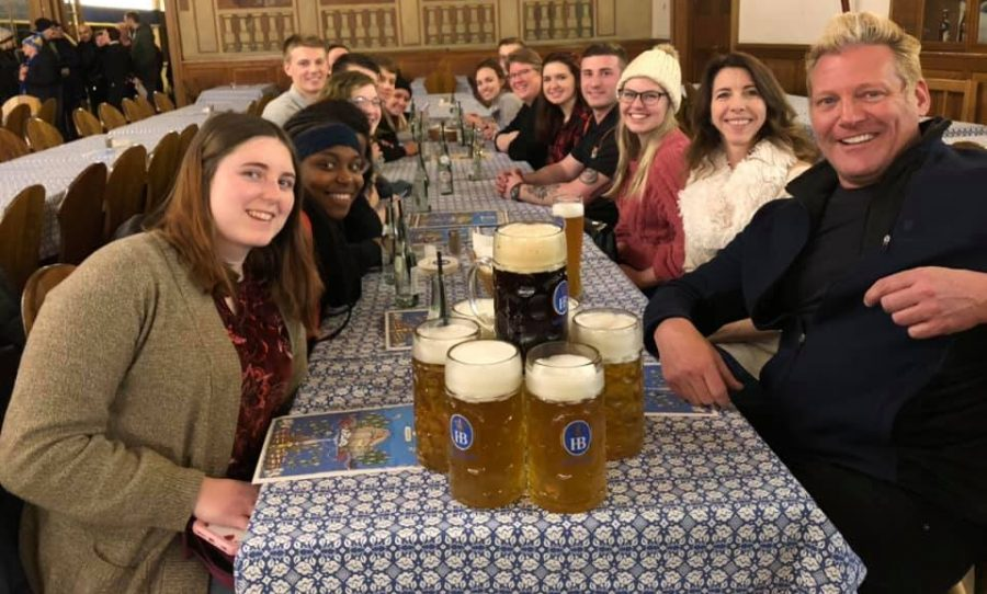 David Domine (right) and a group of his students eat at a restaurant in Munich, Germany on the Paris-Munich KIIS winter trip. Photo provided by David Domine.