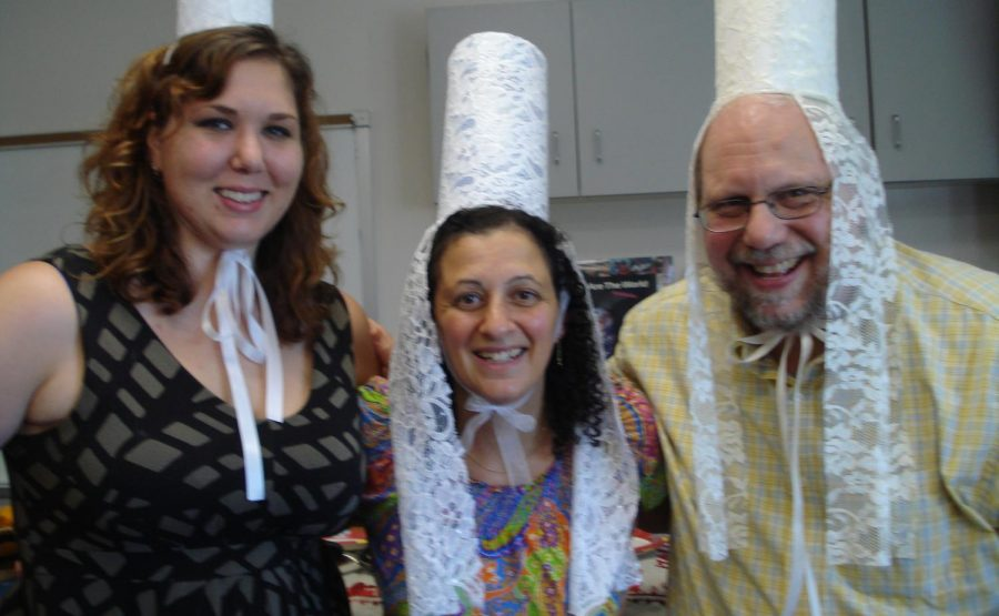 IU Southeast French professor Charles Pooser (right) and two French Club members make traditional hats called coiffes. Photo provided by Charles Pooser.