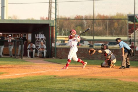 Sophomore outfielder Derek Wagner follows through on his swing as he watches a ball soar out of the park for a two-run blast during the Grenadiers