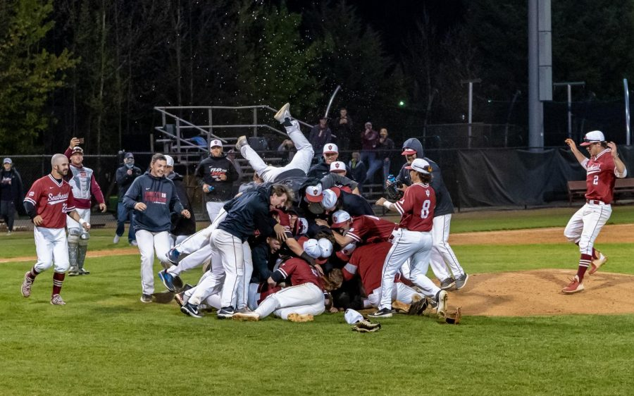 The IU Southeast Baseball team dogpiles in front of the pitcher's mound after sophomore right-hander Drew Hensley finishes off a complete-game against Midway on April 23. The 6-2 victory, which came in the nightcap of a doubleheader, clinched the Grenadiers' third consecutive RSC Regular-Season title and their fifth-straight trip to the NAIA Opening Round.
