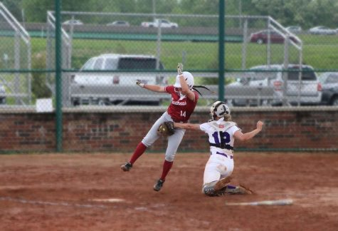 Freshman outfielder Brooklyn Gibbs gets tagged at home plate after a perfect throw from Carlow centerfielder Morgan Nedley, preventing the Grenadiers from scoring in the second inning of the nightcap of a doubleheader against the Celtics on May 3.