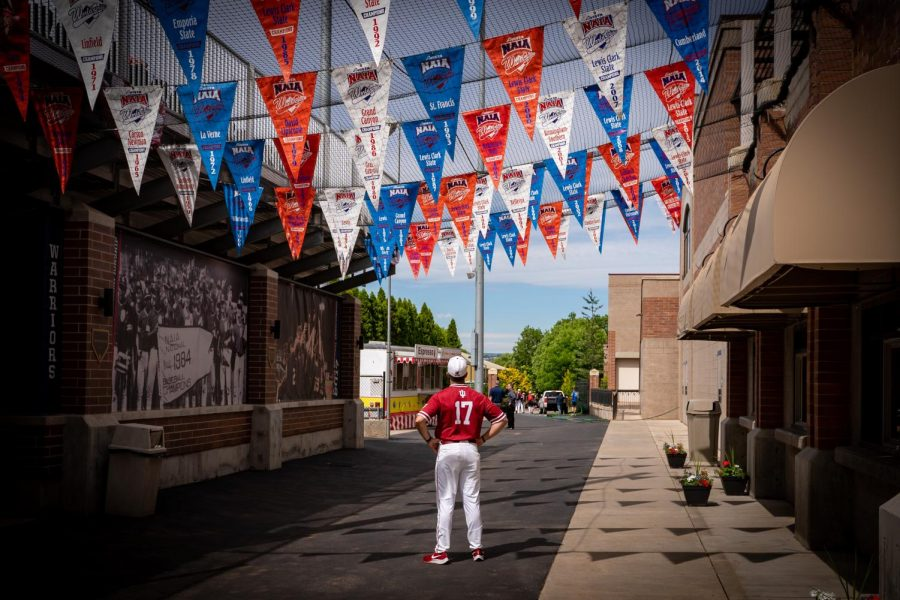 IU Southeast Baseball skipper Ben Reel looks up at the pennants showing every team that has won the NAIA World Series since it began in 1957. Reel hopes that his #15 Grenadiers can add their name to that list as they will participate in the event in Lewiston, ID., for the first time in school history.