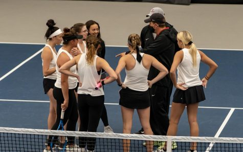 Head coach Joe Epkey gives his Grenadier womens tennis squad a pep talk prior to the singles portion of their RSC Semifinal matchup against IU East on April 23.