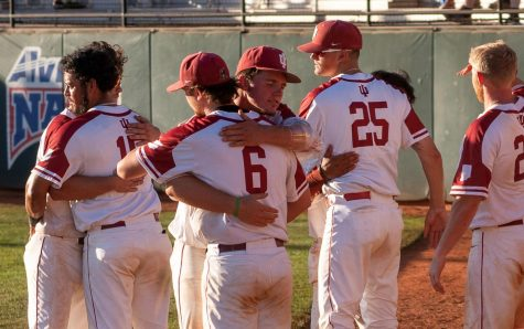 Members of the IU Southeast Baseball team embrace in hugs following their season-ending loss to #11 Faulkner in the NAIA World Series. The #15 Grenadiers finished the 2021 campaign at 50-16 and went 2-2 in their first ever trip to the World Series.