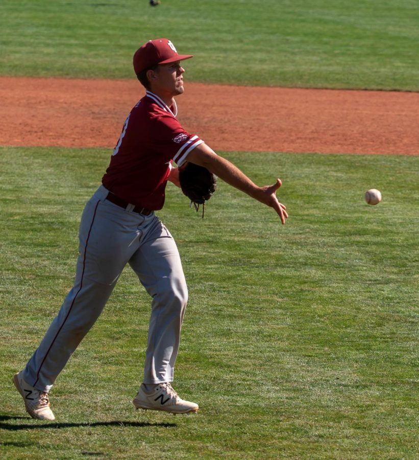 Senior closer Jacob Frankel flips the ball to first base to finish off a 9-7 victory over #17 Keiser University during the Avista NAIA World Series on May 31.