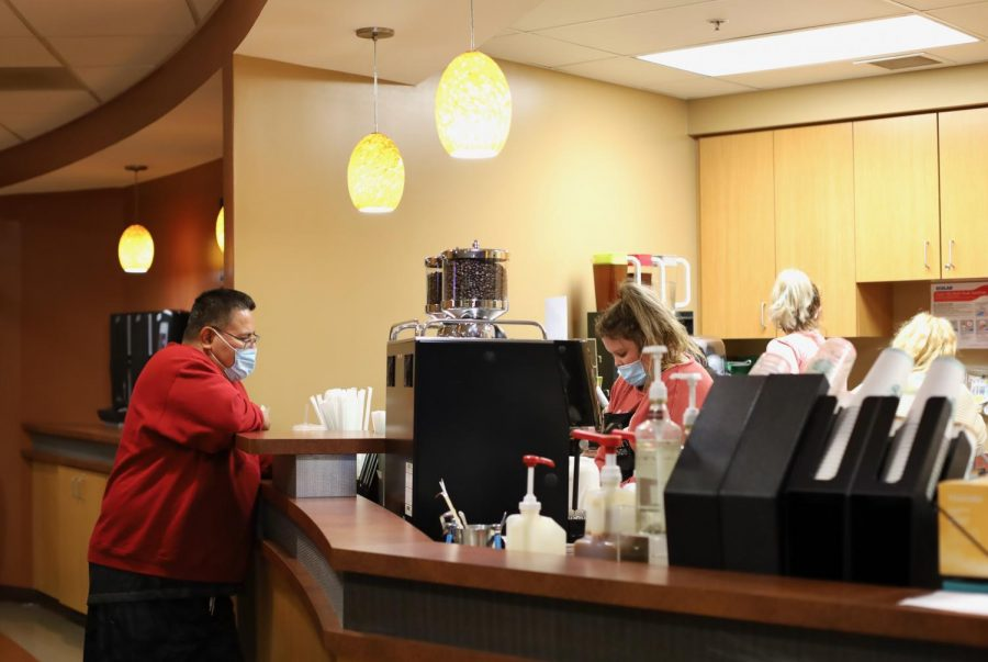 University Grounds barista Kati Curry makes a Starbucks drink for an IUS customer.