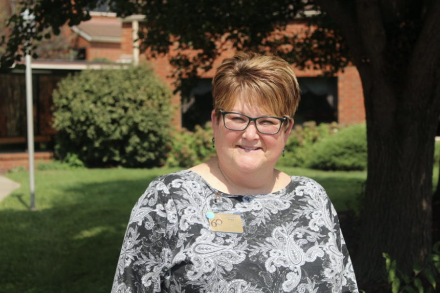LaCosta Fike stands in front of Westminster Village Kentuckiana, where she works as the activities director