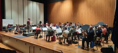 Director Philip Thomas leads the band during their practice on Sept. 23